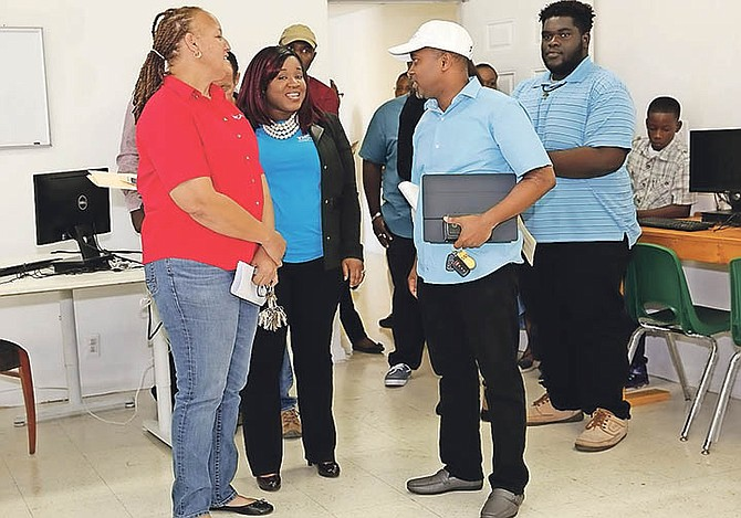 Minister of State for Grand Bahama Kwasi Thompson was given a short tour of the computer lab where the new Computer Coding, ICT Skills Development Programme will be conducted for a series of weeks at the YMCA. At left is Karon Pinder-Johnson, director of the YMCA. Photo: Andrew Miller/BIS