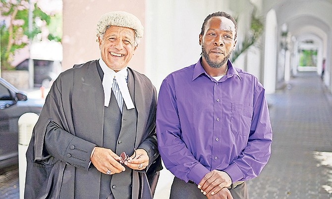 Fred Smith, QC, and Jean Rony Jean-Charles outside the Court of Appeal yesterday. Photo: Terrel W. Carey Sr/Tribune Staff