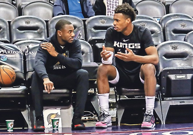 "Lourawls ""Tum Tum"" Nairn (left) chats with Buddy Hield."