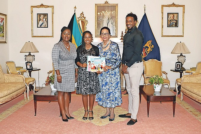 Teen author Sierra Blair (second from left) and illustrator Lamaro Smith (far right) meet with Governor General Dame Marguerite Pindling.
