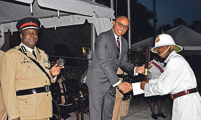 Minister of National Security Marvin Dames at the ceremony for 34 recruits who completed fire training at the Police College in Freeport. Photo: Vandyke Hepburn