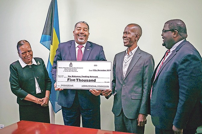 FROM left, Sherrylee Smith, permanent secretary; Minister of Social Services Frankie Campbell; Philip Smith; and Kellen Russell, acting director of Urban Renewal.