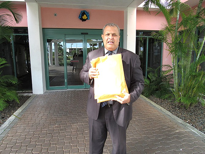 Pastor Eddie Victor delivering copies of the letters of support signed by citizens from East Grand Bahama, to the office of the constituency office of Deputy Prime Minister and Member of Parliment K. Peter Turnquest.