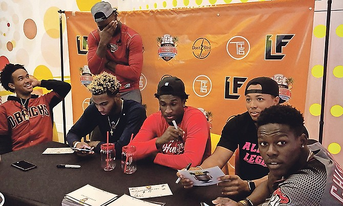 SEATED (l-r) are DJ Collie, Trent Deveaux, Lucius Fox Jr, Todd Isaacs Jr and Jazz Chisholm. Several of the participants in this weekend's Don't Blink Home Run Derby in Paradise hosted a Pop Up Meet and Greet at the REV Cable Bahamas office in the Marathon Mall.