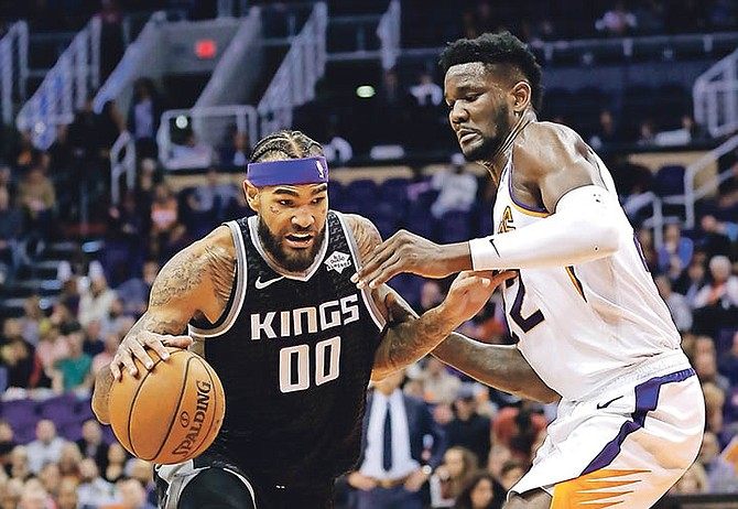 Sacramento Kings centre Willie Cauley-Stein (00) drives to the basket against Phoenix Suns centre Deandre Ayton in the first half last night in Phoenix.
