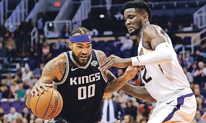 Sacramento Kings centre Willie Cauley-Stein (00) drives to the basket against Phoenix Suns centre Deandre Ayton in the first half in Phoenix.
