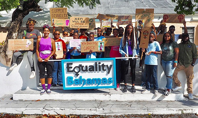 Members of the Equality Bahamas organisation stand together proudly to advocate for women.