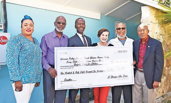 Anonymous doner bestows $168,000 to five Bahamian charities. Pictured, from the left, are Eldri Ferguson-Mackey, DPA partner; L Alexander Roberts, Ranfurly Home administrator; Philip Smith, Bahamas Feeding Network Executive Director; Diane Phillips, DPA president; Joseph Darville, Humane Society Grand Bahama President and Dr Colin Archer, Every Child Counts in Abaco representative. Photos: Shawn Hanna/Tribune Staff