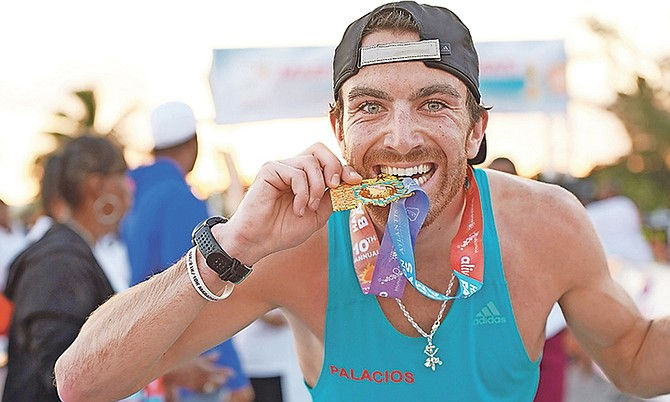 Bryan Morseman, of the United States, celebrates after winning the full marathon during the 10th edition of Sunshine Insurance's Marathon Bahamas Race Weekend. He finished in a time of two hours, 27 minutes and 35 seconds.  Photo: Shawn Hanna/Tribune Staff