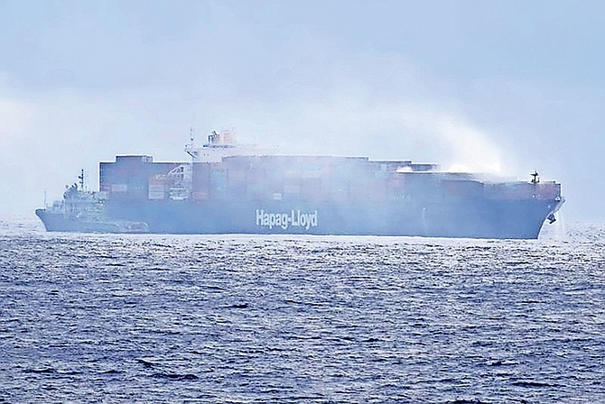 The MV Yantian Express, a 320-metre container vessel, on fire.