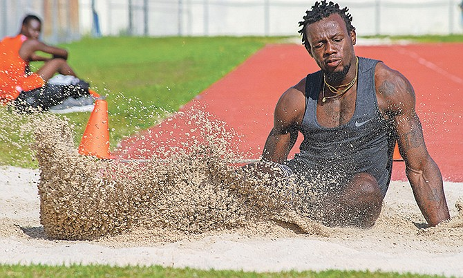 Kendrick Thompson competes in the long jump.