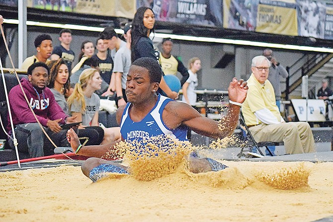 Ken Mullings in action in the long jump as he soared to a new national record in the heptathlon. Photo: UB Bahamas