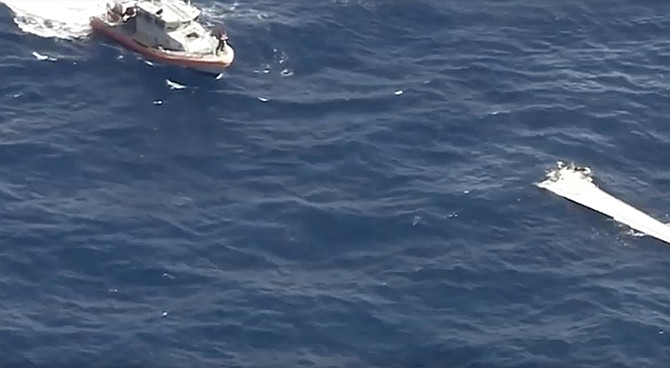 A still from video footage showing a wing from the aircraft on the water.