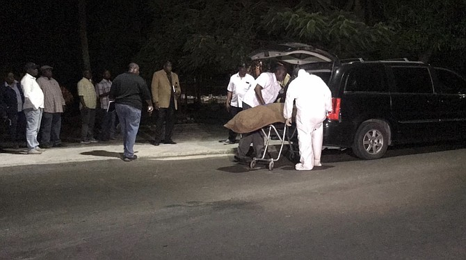 The victim's body is removed from the scene in Fox Hill.