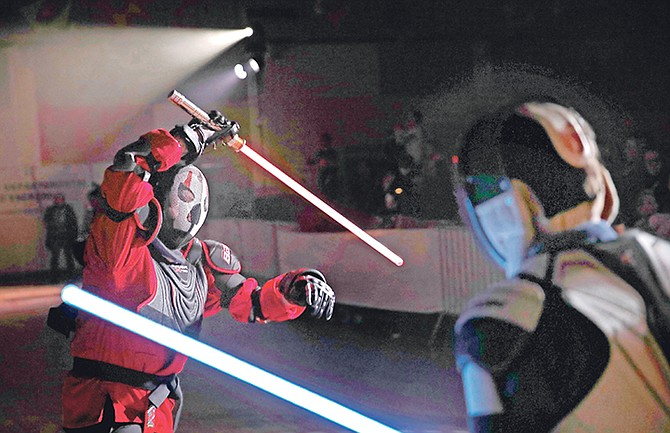"Julien Esprit, left, competes with Jean Baptiste Marchetti-Waternaux during a national lightsaber tournament in Beaumont-sur-Oise, north of Paris. In France, it is easier than ever now to act out ""Star Wars"" fantasies. The fencing federation has officially recognised lightsaber dueling as a competitive sport. Photo: Christophe Ena/AP"