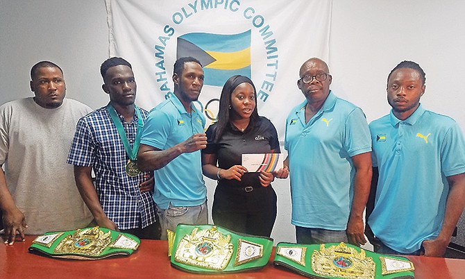 Coach Keishno Major, boxers Lennox Boyce and Carl Hield, Jayme Pinder of Alive, boxing federation president Wellington Strachan and boxer Ronald Woodside.
