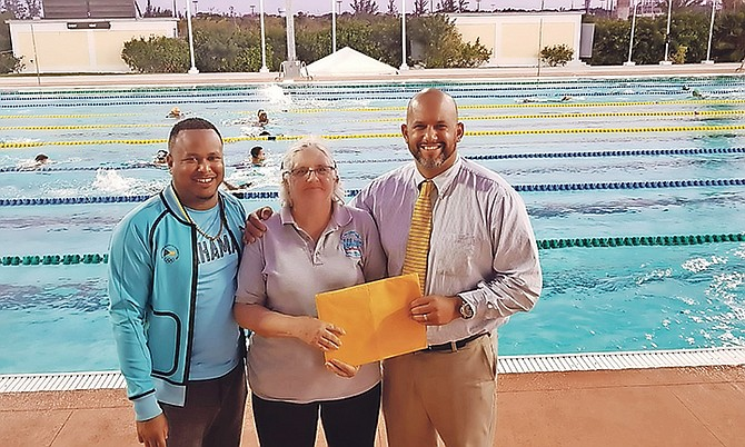 Seawaves' founder Shirley Mireault is greeted by BOC secretary general Derron Donaldson and BTA president Dorian Roach.