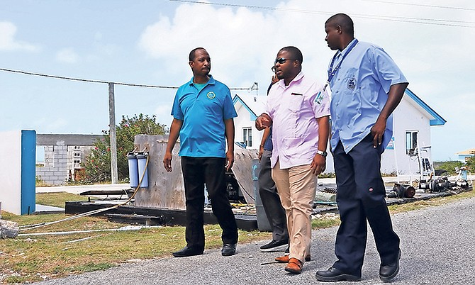 Adrian Gibson, centre, WSC chairman and MP for Long Island, inspects the facilities on Ragged Island last week.
