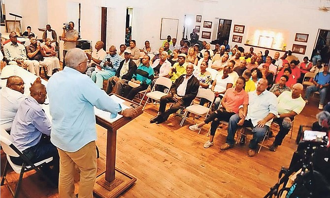 Prime Minister Hubert Minnis addresses a town hall meeting in Eleuthera on Saturday.