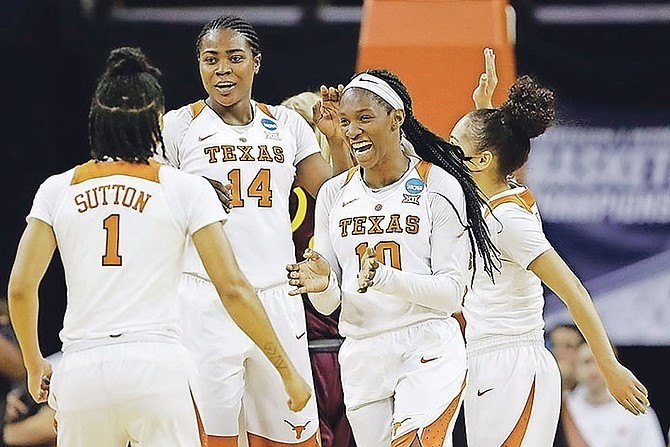 Texas guard Lashann Higgs (10) has received her third selection to the Academic All-Big 12 teams.