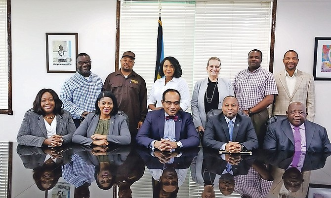 Minister of the Environment and Housing Romauld Ferreira, Minister of State for Grand Bahama Senator Kwasi Thompson and Pakesia Parker-Edgecombe, MP for West Grand Bahama and Bimini, with others involved in the project.
