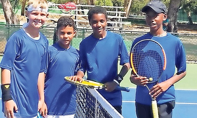 Top Bahamian junior tennis players Dentry Mortimer Jr (3rd from left) and Anthony Burrows Jr (far right) with their doubles opponents from Aruba.