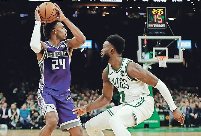 Sacramento Kings guard Buddy Hield (24) looks for room against Boston Celtics guard Jaylen Brown (7) in the second half. (AP Photo/Elise Amendola)