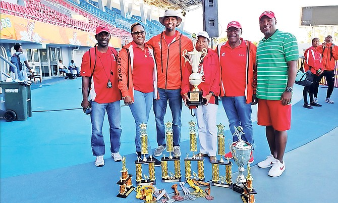 WINNING WAYS: St Augustine's College coaches Tito Moss, Dawn Johnson and Jason Edwards show off their awards with principal Sonia Knowles and coach William 'Knucklehead' Johnson.
