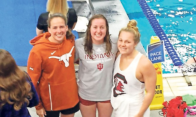 Shown (l-r) are swimmers Joanna Evans, Laura Morely and Albury Higgs.
