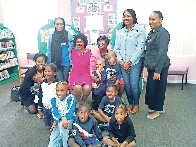 Dorcas Bowler with children participating in reading and reflection for National Library Month.