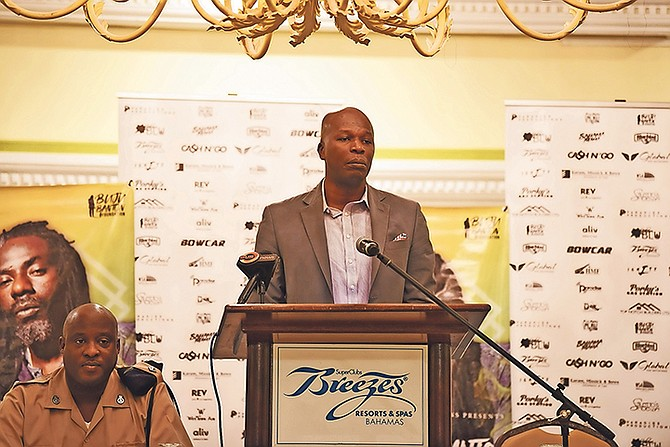 Hubert Edwards, of Cash and Go, speaks at Wednesday's press conference.