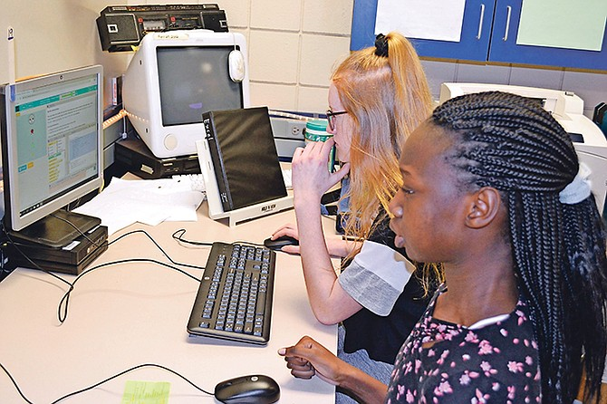 Eighth-graders Jury Okene, front, and Alyssa Lingen evaluate Lingen's video game from Jason Whiting's information and communication technology class at Patrick Henry Middle School in Sioux Falls.
