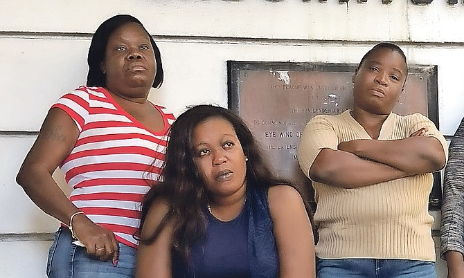 Perry Rolle's mother Gladys Louise (centre). Photo: Shawn Hanna/Tribune staff