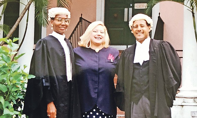 TAMARA MERSON, centre, with her lawyers Fred Smith and Pleasant Bridgewater. Ms Merson was awarded $280,000 damages in 1987 for false imprisonment and the abuse she suffered at the hands of Bahamian police officers. Thirty years later the same issues continue to haunt the Bahamas police.