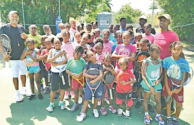 The children who participated in the tournament with, from left, coach Cory Francis, Shayvon Clarke, Bernard Clarke, Perry Newton and coach Mike Butler.