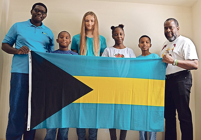 Members of the 2019 Bahamas CARIFTA chess team along with their team coach and corporate sponsor of the team. From left, Elton Joseph, president, Bahamas Chess Federation; Daniel Ramtulla; Aidan Mart; Trinity Pinder; Noah Albury; and Dr Charles W Diggiss, president and owner, the MedNet Group of Companies. Team members not pictured: Marfeeyou Joseph and Aaron Ramtulla.