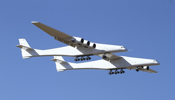 Stratolaunch, a giant six-engine aircraft with the world's longest wingspan, makes its historic first flight from the Mojave Air and Space Port in Mojave, Calif, on Saturday. Founded by the late billionaire Paul G Allen, Stratolaunch is vying to be a contender in the market for air-launching small satellites. Photo: Matt Hartman/AP