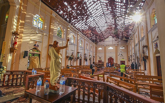 A view of St. Sebastian's Church damaged in blast in Negombo, north of Colombo, Sri Lanka on Easter Sunday. Sri Lankan authorities blame seven suicide bombers of a domestic militant group for coordinated Easter bombings that ripped through Sri Lankan churches and luxury hotels which killed and injured hundreds of people. It was Sri Lanka's deadliest violence since a devastating civil war in the South Asian island nation ended a decade ago. (AP Photo/Chamila Karunarathne, file)