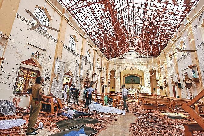 Bodies of victims lie inside St Sebastian's Church damaged in blast in Negombo, north of Colombo, Sri Lanka on Sunday.