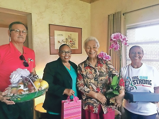 The Long Islanders' Association members visited Dame Ivy Dumont on Monday to present her with a plaque for Nation Building, a 'Long Island Strong' Long Island week T-shirt, a fruit basket and an assortment of jams and jellies from Long Island; presented by Henderson Burrows, Dr Ruth Sumner, Cheryl Deal and president Gina Coakley.