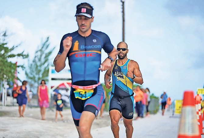 JASON Costelloe leads the way with Bahamian national champion Jorge Marcos close behind Sunday morning. Costelloe pulled away from Marcos to take the title in the newly implemented Olympic Triathlon, comprising of a 1,500 metre swim, 26-mile bike and 6-mile run.