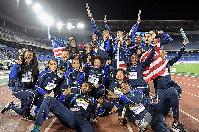 THE US relay team pose for a group photo after winning the 'golden baton' at the IAAF World Relays Sunday in Yokohama, Japan. (Nozomi Endo/Kyodo News via AP)