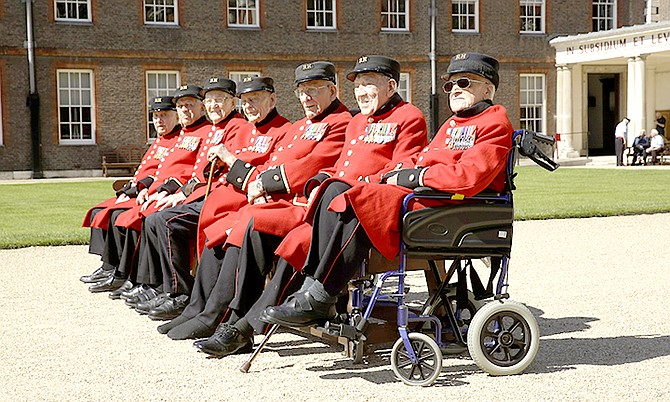 British Chelsea Pensioners who are veterans of the World War II Battle of Normandy, codenamed Operation Overlord, and D-Day pose for a group photograph during a D-Day 75th anniversary photocall at the Royal Hospital Chelsea in London yesterday.
