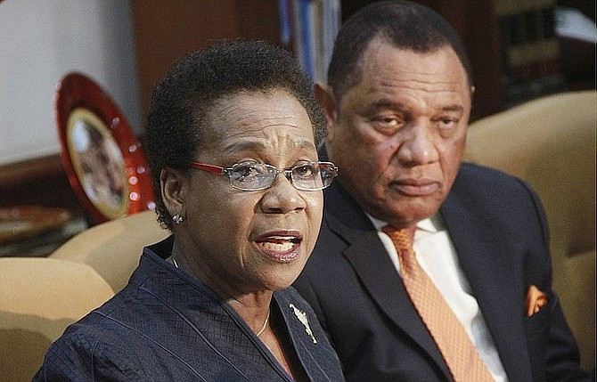 Retired Justice Rubie Nottage with former Prime Minister Perry Christie