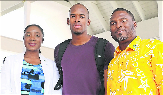 STEVEN GARDINER (centre) with Minister of Youth, Sports and Culture Lanisha Rolle and Drumeco Archer, president of the BAAA.