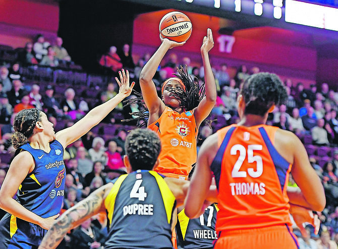 Connecticut Sun centre Jonquel Jones shoots over the Indiana Fever defence on Tuesday night.