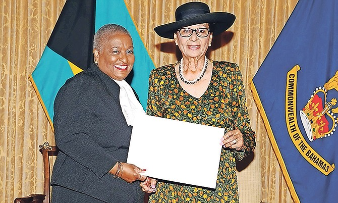 Ruth Bowe-Darville is sworn in as Justice of the Supreme Court by Dame Marguerite Pindling. Photo: Letisha Henderson/BIS