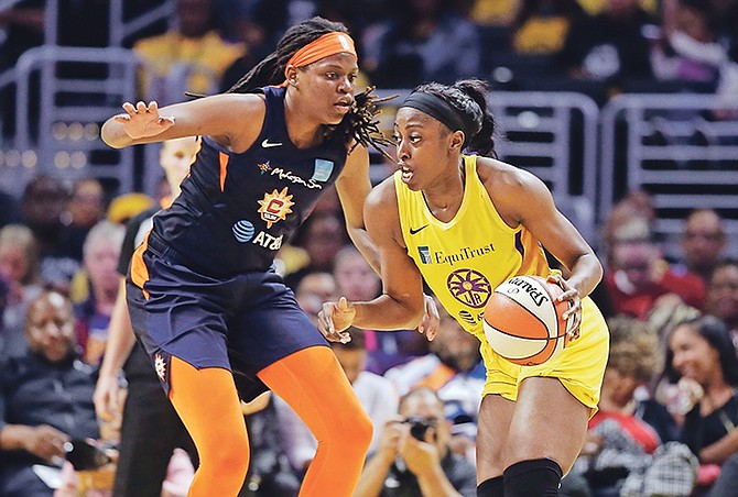 Los Angeles Sparks' Chiney Ogwumike, right, is defended by Connecticut Sun's Jonquel Jones during the first half of Friday's game in Los Angeles.  (AP Photo/Marcio Jose Sanchez)