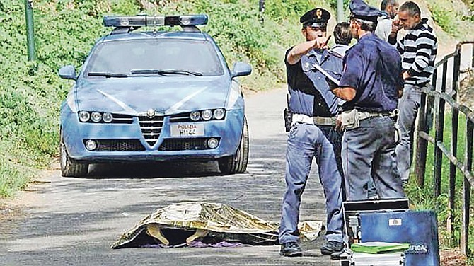 Officers at the scene in Italy after a Bahamian diplomat's body was found in a river.