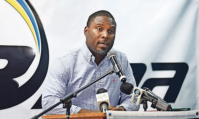 Drumeco Archer, president of the Bahamas Association of Athletic Associations, speaks yesterday during a press conference in the BAAA office at the original Thomas A Robinson Track and Field Stadium.